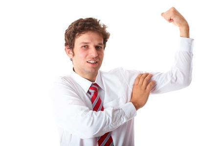 young businessman in white shirt and red tie shows his strength, isolated on white photo