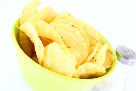 grasas saturadas: Pila de papas fritas de amarillo y verde  Foto de archivo
