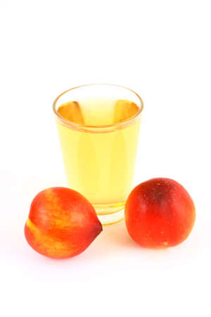 Glass of icetea and nectarine fruit - close-up photo