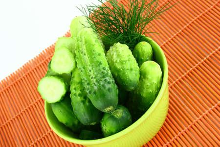 progressively: A Cucumber progressively sliced on a white background