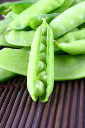 Close-up of green pea pods with depth of field