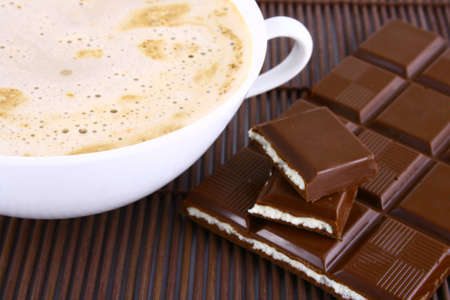 Cup of coffee with chocolate Frothy cappuccino coffee. Stock Photo