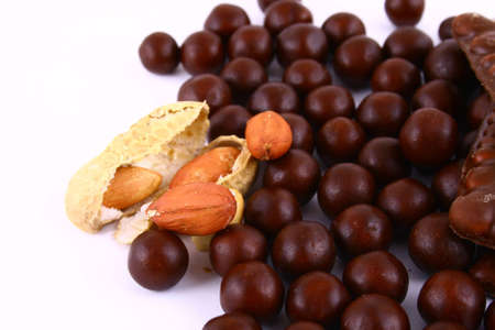 black and brown chocolate sweets against white background Stock Photo