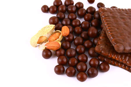 half stuff: black and brown chocolate sweets against white background Stock Photo