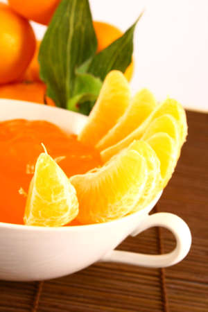 Orange Ripe tangerines on a white background with jelly photo