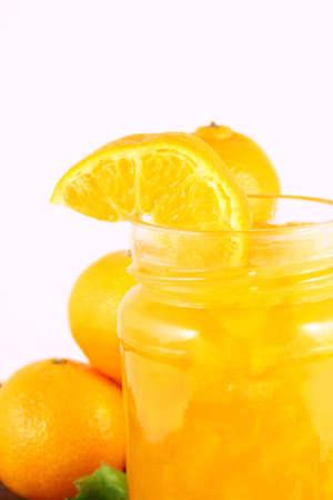 Orange Ripe tangerines on a white background with jam Stock Photo - 2362282