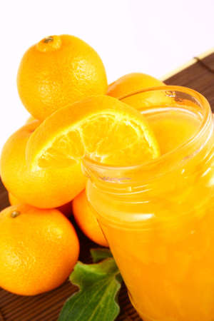 Orange Ripe tangerines on a white background with jam photo