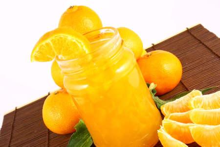 Orange Ripe tangerines on a white background with jam Stock Photo - 2362336