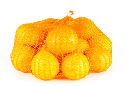 orange Clementines in a netted bag and box Stock Photo