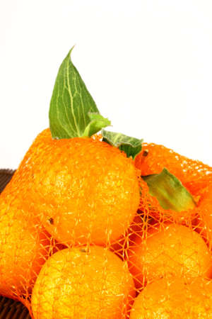 clementines: orange Clementines in a netted bag and box Stock Photo
