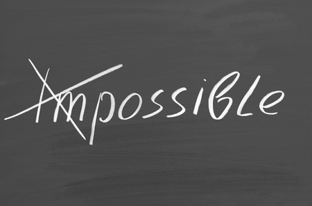 Impossible possible. Text on chalkboard. Inspirational quote Imagens - 117465857
