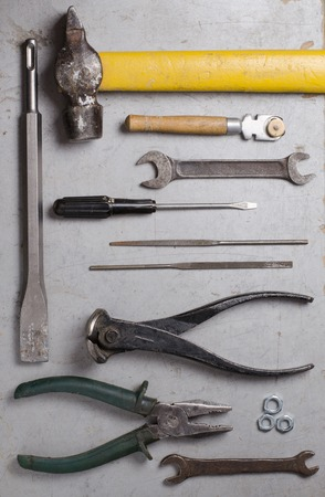 Set of hand  old tools on grey background. Top view. Vertical photo