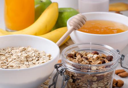Healthy Breakfast - Oatmeal with raisins. Honey, bananas, green apples, nuts