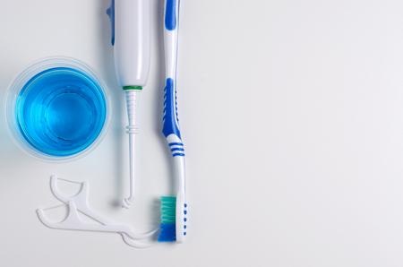 Dental hygiene. Toothbrush, mouthwash, dental floss, oral irrigator. Flat top view