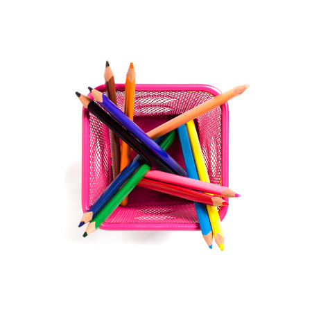 Color pencils in red metal pot. Flat top viev