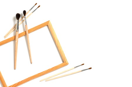 Accessories for drawing. Wooden frame and brush. Flat top viev. Space for text.