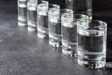 Six shots of vodka in a row. Copy space