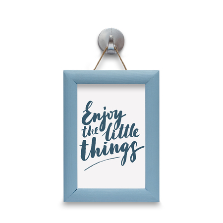 Enjoy the little things - motivational quote. Stylized lettering. Blue wooden frame. Isolated on white