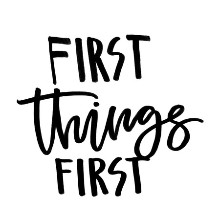 First things first. Handwritten text. Modern calligraphy. Isolated on white