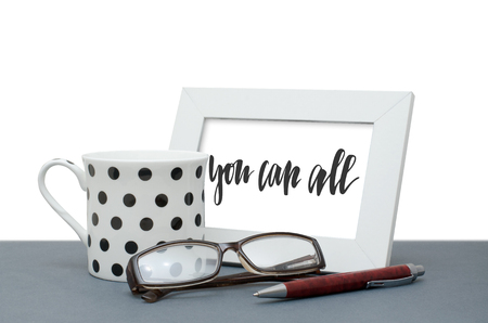 You can all. Handwritten inscription in the frame. Coffee Cup, glasses, pen. Close-up Stok Fotoğraf