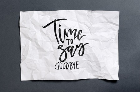 Time to say goodbye. Handwritten text on white crumpled paper. Modern calligraphy. Inspirational quote.