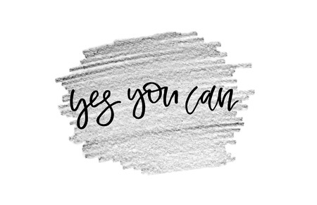 Yes you can. Handwritten text, modern calligraphy. Inspirational quote. Close-up. Grey background