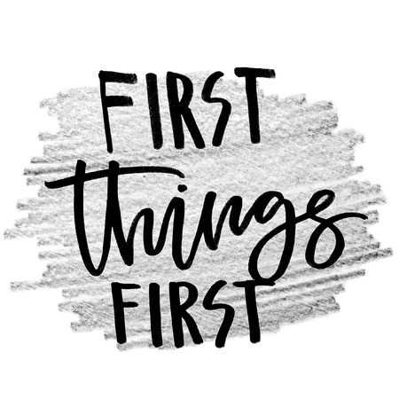 First things first. Handwritten text, modern calligraphy. Inspirational quote. Grey background