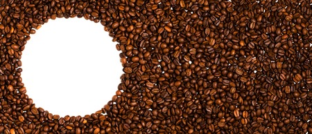 Background of roasted coffee beans. Space for text in the form of a circle