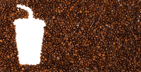 Background of roasted coffee beans. Space for text in the shape of a coffee plastic Cup