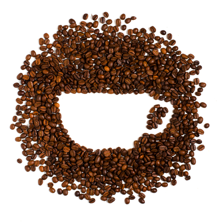 Roasted coffee beans on white background. Space for text in the shape of a coffee Cup Banco de Imagens