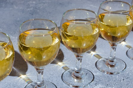 White wine in glass glasses. Blue background. Close up Banco de Imagens