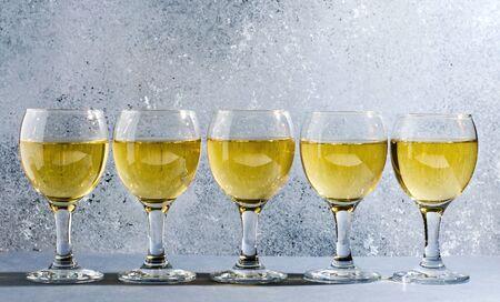 White wine in glass wine glasses. Blue background. Copy space. 写真素材