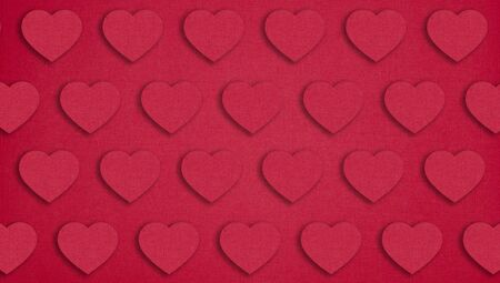 Red paper hearts on red background. Valentines day concept