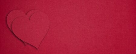 Red paper hearts on red background. Valentines day concept. Copy space