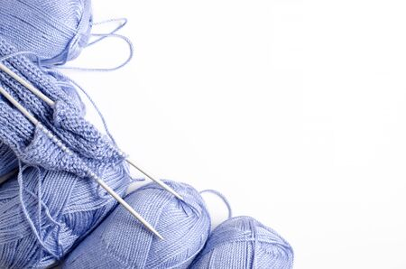 Balls of blue yarn and knitting needles. White background. Copy space. The concept of women 's needlework. Фото со стока - 146386163