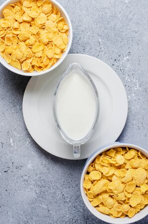 Corn flakes and milk. Healthy diet. Flat top view. Copy space.