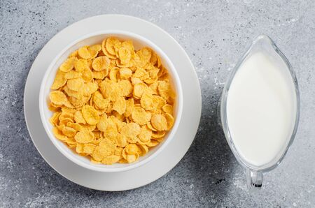 Corn flakes and milk. Healthy diet. Flat top view.