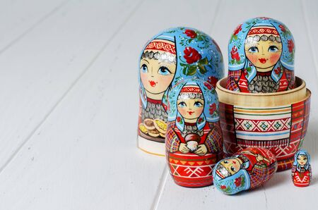 Five red matryoshka. Traditional Russian toy. Copy space. White wooden background Stock fotó