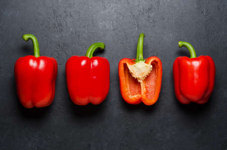Red pepper on a black background. Paprika. The species capsicum annuum. Copy space.