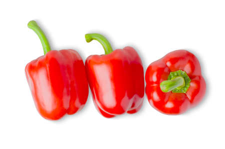 Paprika. Three red bell peppers. Isolated on a white background. The view from the top. Фото со стока