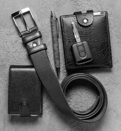 Men's accessories on a black concrete background. The concept of father's day