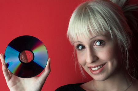 Attractive blond girl hold cd. photo