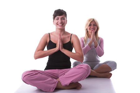 Attractive girls in yoga pose. Stock Photo