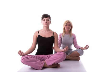 Yoga pose by two attractive young woman. Stock Photo - 1780067