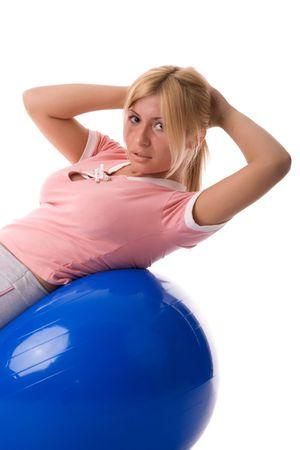 Fitness girl exercising over pilates ball.