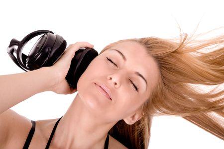 Beautiful young woman enjoy in music. photo