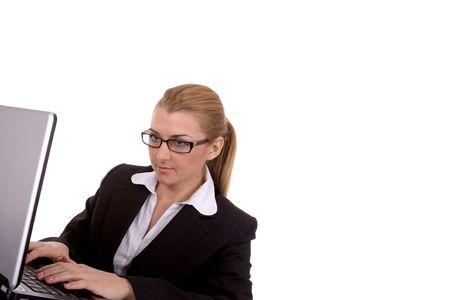 intelligently: Businesswoman using laptop.