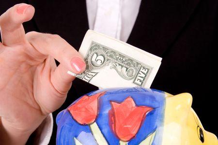 Businesswoman savings money over white background. Stock Photo - 2694421