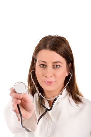 ordination: Friendly young doctor with stethoscope over white background. Stock Photo