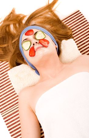 Beautiful girl with facial mask and fruit. Stock Photo - 3004978